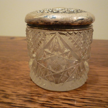 Item from a vanity set, silver topped.