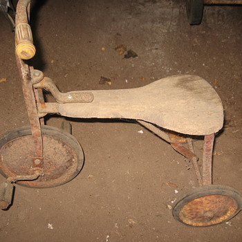 metal tricycle with wooden seat