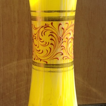 Yellow and white decorated vase.