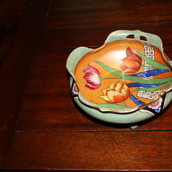 pretty 3 footed bowl, orange opalescent inside - Art Pottery