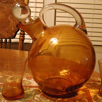 Orange pitcher and 3 glasses, 7 inches tall, What kind of glass? when made?Mystery solved! Cambridge glass 1930&#039;s art deco