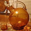 Orange pitcher and 3 glasses, 7 inches tall, What kind of glass? when made?Mystery solved! Cambridge glass 1930's art deco