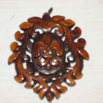 Any history of what this carved wood piece of jewelry is? - Fine Jewelry
