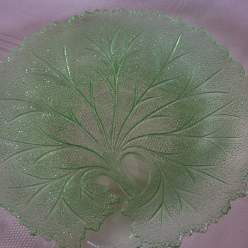Green depression glass plate and crystal pitcher