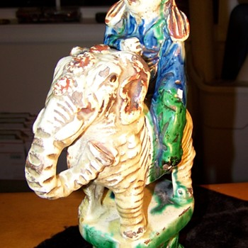 Antique statue man riding elephant with animal on his head????? - Pottery