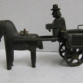 carved horse and wagon.very unusual.