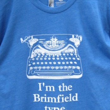 We're here at Brimfield, with t-shirts!