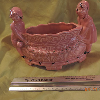 PINK GLAZED 4 FOOTED PLANTER WITH GIRL & BOY