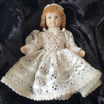 Victorian Porcelain Doll with Braided Hair
