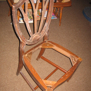 A set of federal shield back chairs.