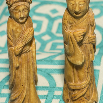 Small male and female bone statues