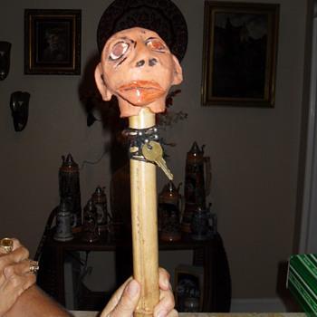 """""""head on a stick"""" face jug"""