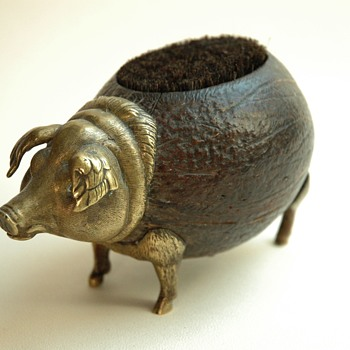 victorian coconut & bronze pen wiper figuring a pig.  19th century.