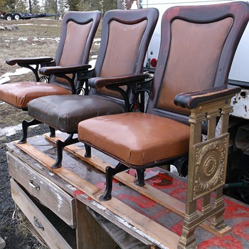 Rows of 3 ornate Premium Theater seats