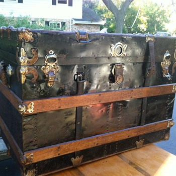Black metal flat top trunk