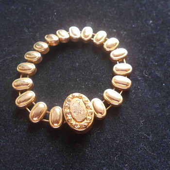 Vintage Childs Initial Goltone bracelet marked Pat. 1906 - Costume Jewelry