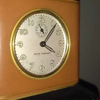 neat little american made Seth Thomas leather wrapped alarm clock