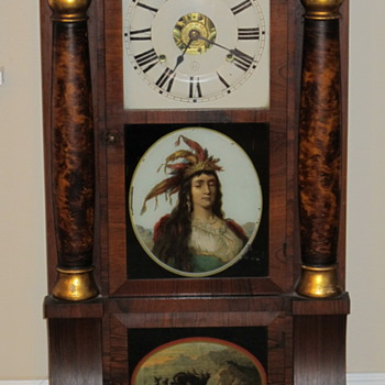 Antique clock with American Indian on face - Clocks