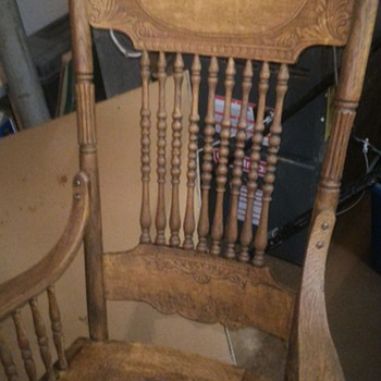 Antique rocking chair with tooled leather seat.