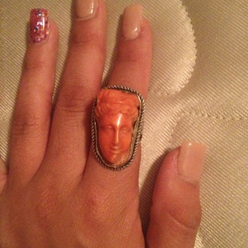 Carved coral and silver ring