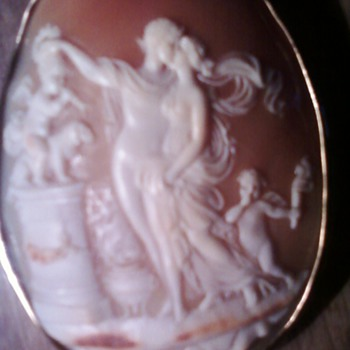 Shell cameo of love?  or a wedding?