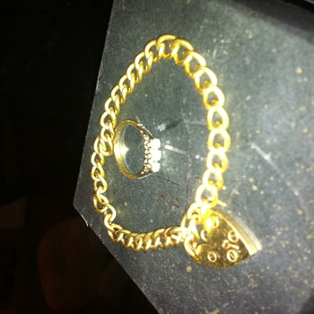 9 ct 18 g solid gold charm braclet and gold and platinum dimond ring