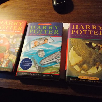 3 harry potter books signed by J.K rowling