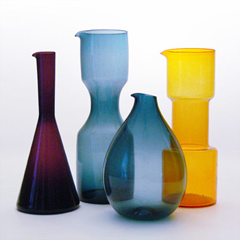 Three jugs designed by Kjell Blomberg for Gullaskruf and a yellow jug by Bo Borgstrm for Aseda