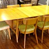 "Heywood Wakefield ""Harmonic"" Drop Leaf Table with 2 leaves and 6 chairs."