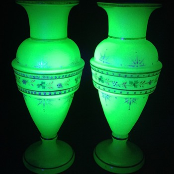 Two frosted uranium green vases.