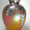 Wondering who made this Bohemian vase? Silver by La Pierre.
