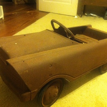 Old rusty metal pedal car - Toys