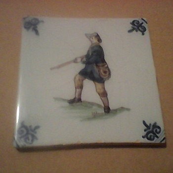 A HUNTER AND SHIP TILES - Art Pottery