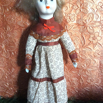 Blond Haired Porcelain Bisque Doll in Brown Calico Dress, unknown age or maker - Dolls