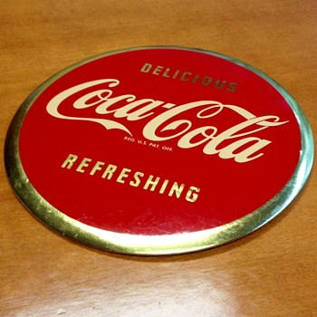 1940 and 1950 celluloid Coca Cola hangers