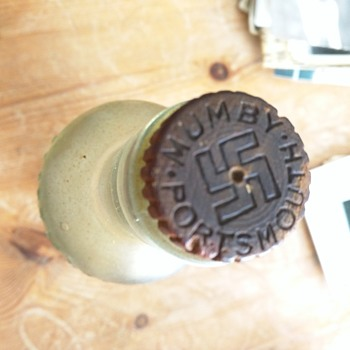 Mumby's glass bottle with swastika on cork