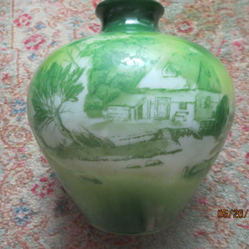 Green vase with white glass underneath--no signatures or marks