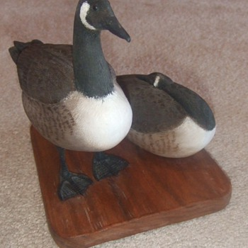 Hand Carved and painted Canada Geese on wood display stand