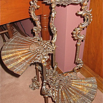 Antique Ornante 3 tier fan table.