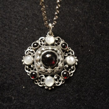 Austro-Hungarian style garnet & m.o.p. silver pendant and chain.