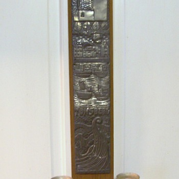 Tonsberg Hammered Aluminum Wall Hanging with wood candleholders.