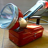 Old red flashlight with emergency red/strobe light