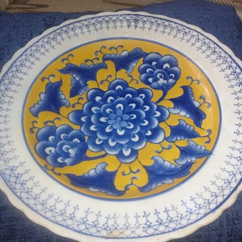 Blue, yellow and white porcelain Asian plate