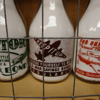 War Slogan Milk Bottles With Airplanes....