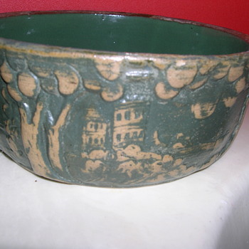 Solid bowl with landscape designs