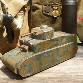 Large wartime pull toy, possibly home made, custom comoflouge.