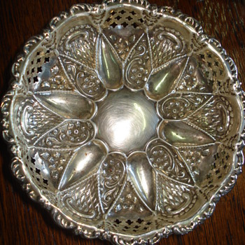 An elaborated sterling pierced almond dish or bowl