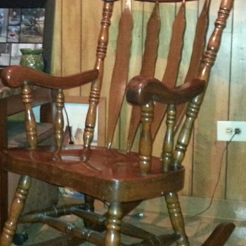 Large solid wood carved rocking chair