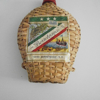 Vintage weaved cane bamboo bottle