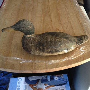 Anyone know the designer of these wood decoys?